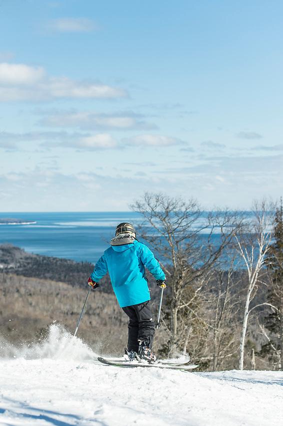 Skiers on the open runs of Mount Bohemia ski area in Michigan.