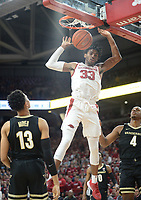 Arkansas guard Jimmy Whitt Jr. (33) dunks Wednesday, Jan. 15, 2020, over Vanderbilt forward Matthew Moyer (13) during the first half in Bud Walton Arena. Check out nwaonline.com/photos for a gallery from the game. (NWA Democrat-Gazette/Andy Shupe)