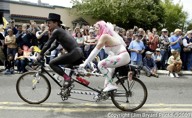 Painted up as newly weds, a couple ride tandem in the 21st annual Summer Solstice Parade held Saturday, June 20, 2009 in Seattle, Wa. The parade was held Saturday, bringing out painted and naked bicyclists, bands, belly dancers and floats. (Jim Bryant Photo © 2009)