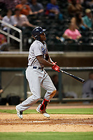 Pensacola Blue Wahoos right fielder Aristides Aquino (6) follows through on a swing during a game against the Birmingham Barons on May 8, 2018 at Regions Field in Birmingham, Alabama.  Birmingham defeated Pensacola 5-2.  (Mike Janes/Four Seam Images)