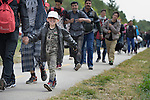 Refugees and migrants--some of them children--walk through the Hungarian town of Hegyeshalom on their way to the border where they will cross into Austria. Hundreds of thousands of refugees and migrants flowed through Hungary in 2015, on their way from Syria, Iraq and other countries to western Europe.