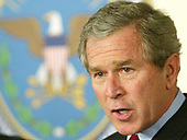 United States President George W. Bush speaks during a visit to the Pentagon March 25, 2003 in Arlington, Virginia. Bush asked Congress for a wartime supplemental appropriations of $74.7 billion to fund needs directly arising from the war in Iraq and the global war against terror.   <br /> Credit: Alex Wong / Pool via CNP