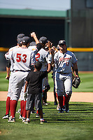 Altoona Curve right fielder Stetson Allie (13) high fives teammates after a game against the Erie SeaWolves on July 10, 2016 at Jerry Uht Park in Erie, Pennsylvania.  Altoona defeated Erie 7-3.  (Mike Janes/Four Seam Images)