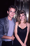 Luke Perry and Alexandra Wilson attend a Soap party on August 2, 1987 in New York City.