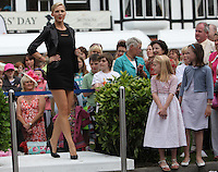 6/08/2009.Model Sarah McGovern is watched by Julie Ringrose (8) & Triona Hinkson (8) both from Blackrock at the  Ladies day competition during the Failte Ireland Dublin horse Show at the RDS, Dublin..Photo: Gareth Chaney Collins.
