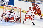 Kieran Millan (BU - 31), David Warsofsky (BU - 5), Sergio Somma (Ohio State - 44) - The Boston University Terriers defeated the Ohio State University Buckeyes 8-3 in the 2009 Northeast Regional Semifinal on Saturday, March 28, 2009, at the Verizon Wireless Center in Manchester, New Hampshire.