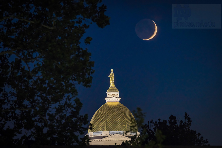 July 25, 2017; Waxing crescent moon sets behind the Dome. (Photo by Matt Cashore/University of Notre Dame)