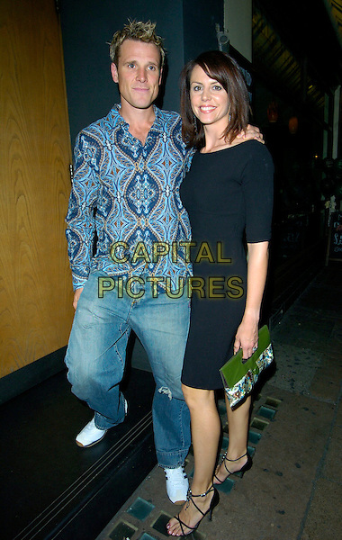 JAMES CRACKNELL & BEVERLEY TURNER.Attend actress Kate Ford's Engagement Party, Century, London, England, May 5th 2007..full length couple jeans blue patterned shirt black dress.CAP/CAN.©Can Nguyen/Capital Pictures
