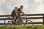 Williamsport River walk. Father and son cycling.