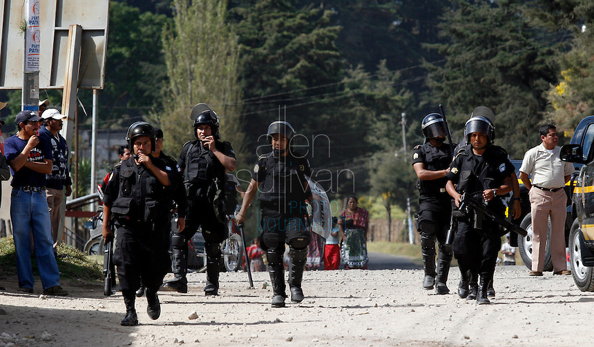 Police arrive to help others contain protests by indigenous people against U.S. President Bush in Tecpán Guatemala, Guatemala. Bush visited a nearby Mayan site, Iximché.