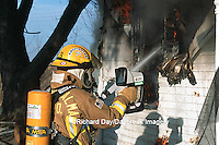 63818-01502 Firefighter using thermal imaging camera at house fire  Kinmundy-Alma Fire District,  Kinmundy IL