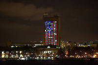 The lights of MIT's Green Building light up to resemble an American flag in response to the bombings at the 2013 Boston Marathon.