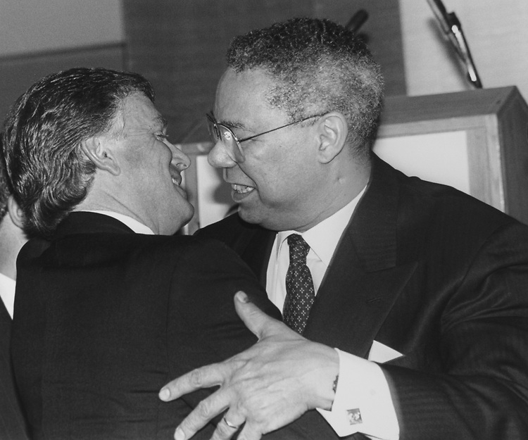 Former Vice President Dan Quayle and General Colin Powell, Former Chairman of the Joint Chiefs of Staff, embrace each other at the tribute to Bob Michel, on March 8, 1994. (Photo by Maureen Keating/CQ Roll Call via Getty Images)