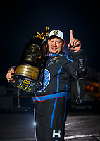 Nov 12, 2017; Pomona, CA, USA; NHRA funny car driver Robert Hight poses for a portrait with the trophy after clinching the 2017 world championship during the Auto Club Finals at Auto Club Raceway at Pomona. Mandatory Credit: Mark J. Rebilas-USA TODAY Sports