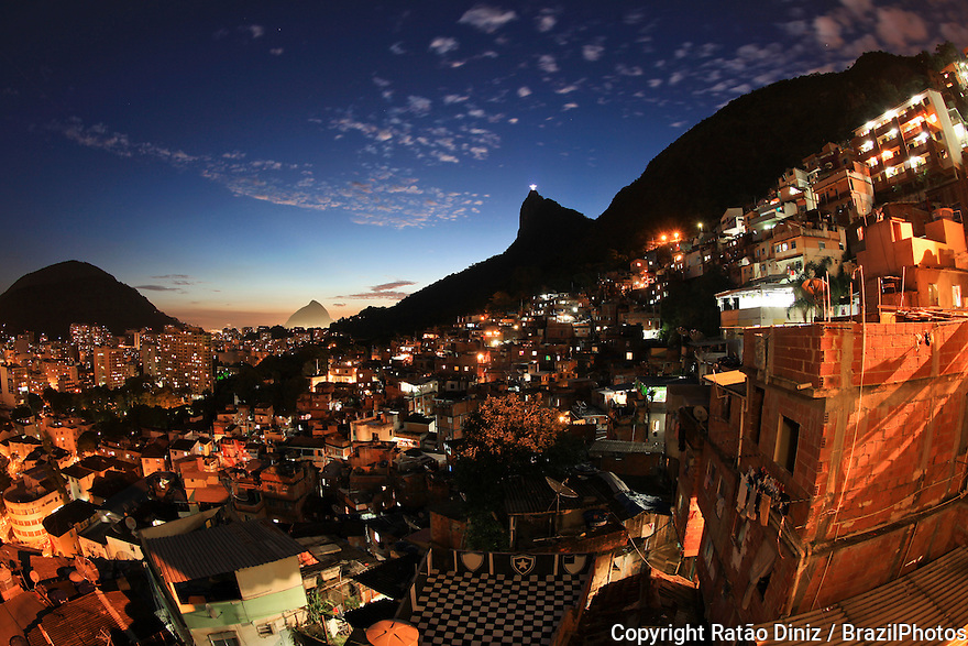 Nigh view from top of Favela Santa Marta, Christ the Redeemer in background. Since 2008 Santa Marta has a Pacifying Police Unit ( Unidade de Polícia Pacificadora, also translated as Police Pacification Unit ), abbreviated UPP, a law enforcement and social services program which aims at reclaiming territories, more commonly favelas, controlled by gangs of drug dealers.
