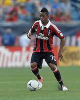 AC Milan forward Robinho (70) dribbles. In an international friendly, AC Milan defeated C.D. Olimpia, 3-1, at Gillette Stadium on August 4, 2012.