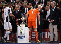 Calcio, finale Tim Cup: Milan vs Juventus. Roma, stadio Olimpico, 21 maggio 2016.<br /> Juventus&rsquo; goalkeeper Gianluigi Buffon, center, back to camera, receives the medal from Italian President Sergio Mattarella as Juventus&rsquo; Leonardo Bonucci, left, greets Italian Football League's president Maurizio Beretta at the end of the Italian Cup final football match between AC Milan and Juventus at Rome's Olympic stadium, 21 May 2016. Juventus won 1-0 in the extra time. At right, CONI's president Giovanni Malago'.<br /> UPDATE IMAGES PRESS/Isabella Bonotto