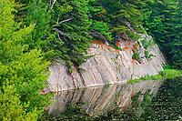 Granite reflected in wetland,<br /> Killarney District<br /> Ontario<br /> Canada