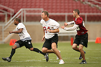 21 April 2007: Corey Hill, Greg Baty and Matt Weiss during the Alumni's 38-33 victory over the coaching staff during a flag football exhibition at Stanford Stadium in Stanford, CA.