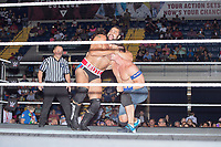 Rusev, The Bulgarian Brute, (left) holds John Cena during their match at a WWE Live Summerslam Heatwave Tour event at the MassMutual Center in Springfield, Massachusetts, USA, on Mon., Aug. 14, 2017. Rusev lost the match.