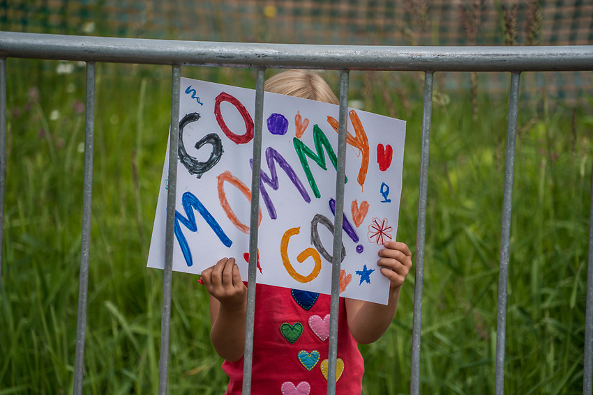 Young fans cheer on their mom at the start of the cross country race during Marquette Trails Fest in Marquette, Michigan.