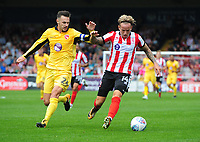 Lincoln City's Jordan Maguire-Drew shields the ball from Morecambe's Michael Rose<br /> <br /> Photographer Chris Vaughan/CameraSport<br /> <br /> The EFL Sky Bet League Two - Lincoln City v Morecambe - Saturday August 12th 2017 - Sincil Bank - Lincoln<br /> <br /> World Copyright &copy; 2017 CameraSport. All rights reserved. 43 Linden Ave. Countesthorpe. Leicester. England. LE8 5PG - Tel: +44 (0) 116 277 4147 - admin@camerasport.com - www.camerasport.com