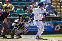 Round Rock outfielder Jim Adduci (24) follows through on his swing against the Nashville Sounds in the Pacific Coast League baseball game on May 5, 2013 at the Dell Diamond in Round Rock, Texas. Round Rock defeated Nashville 5-1. (Andrew Woolley/Four Seam Images).