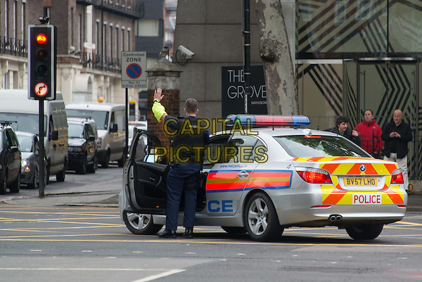 Michael Adebowale driven to Westminster Magistrates' Court, London, charged with the murder of soldier Lee Rigby, London, England.<br /> May 30th, 2013<br /> gv general view police car officer traffic street road sirens <br /> CAP/BF<br /> &copy;Bob Fidgeon/Capital Pictures