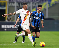 Calcio, Serie A: Inter Milano - AS Roma, Giuseppe Meazza stadium, December 6, 2019.<br /> Roma's Aleksandar Kolarov (l) in action with Inter's Antonio Candreva (r) during the Italian Serie A football match between Inter and Roma at Giuseppe Meazza (San Siro) stadium, on December 6, 2019.<br /> UPDATE IMAGES PRESS/Isabella Bonotto