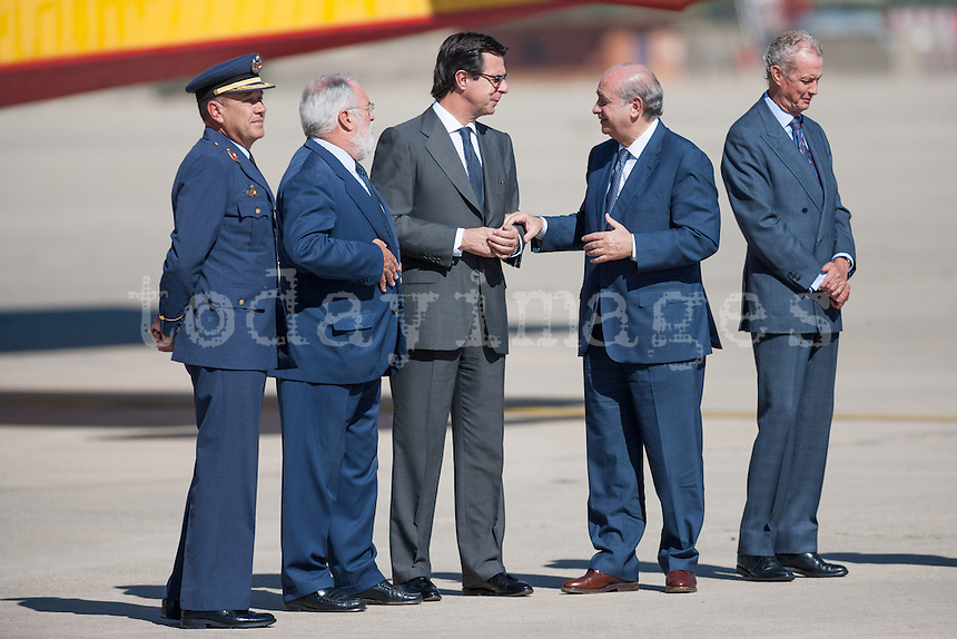 Ministers Miguel Angel Arias CaÒete, Jose Manuel Soria, Jorge Fernandez Diaz await the arrival of Prime Minister Mariano Rajoy