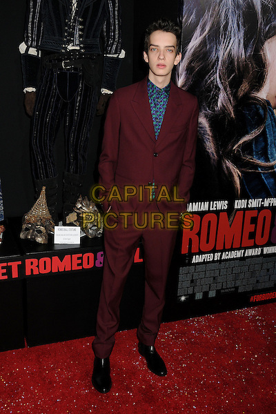 Kodi Smit-McPhee<br /> &quot;Romeo &amp; Juliet&quot; Los Angeles Premiere held at Arclight Cinemas, Hollywood, California, USA.<br /> September 24th, 2013<br /> full length maroon burgundy suit purple green print shirt<br /> CAP/ADM/BP<br /> &copy;Byron Purvis/AdMedia/Capital Pictures