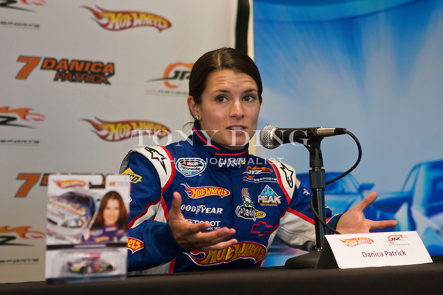 Danica Patrick speak at a press conference for the debut of the new Hot Wheels NASCAR sponsored racecar, featuring its iconic red and orange flames, Thursday, Aug. 12, 2010, at Michigan International Speedway in Brooklyn, Mich. Patrick will race in this new Hot Wheels vehicle at this weekend's CARFAX 250 Nationwide race. (Tony Ding/ AP Images for Mattel, Inc.)