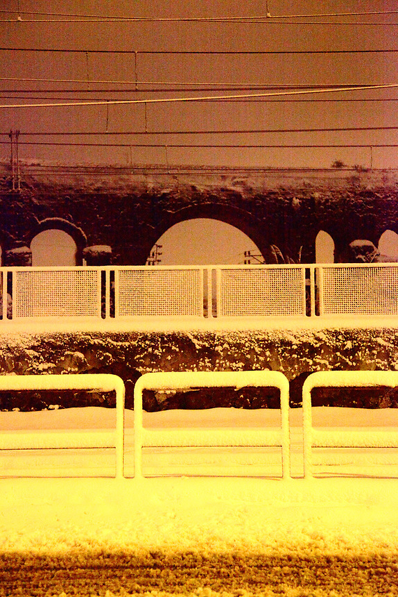 Rome, Casilina: An artistic view of some ancient arcs of the Felice aqueduct. The photo is taken on the Casilina road, by walking along the railway, in the very early morning after a snowing night. The Felic aqueduct is on the background (February, 2012).