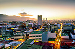 The sun sets behind the mountains of San Jose, the capital and largest city of Costa Rica. The Cordillera Central mountain range, a volcanic range, surrounds the city in the country's Central Valley.