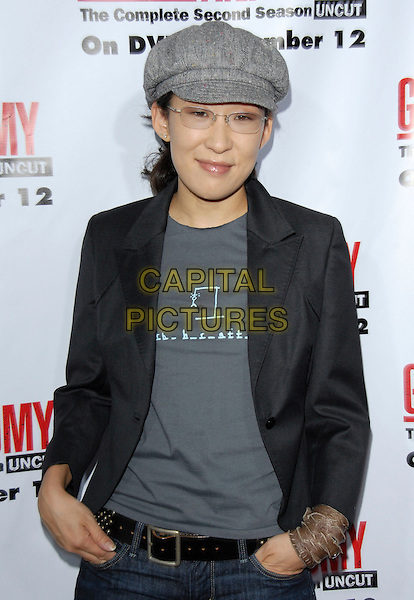 SANDRA OH.The Grey's Anatomy 2nd Season DVD Launch held at Social in Hollywood, California, USA..September 5th, 2006.Ref: DVS.half length grey gray hat black jacket hands in pockets hangman print bracelet glasses.www.capitalpictures.com.sales@capitalpictures.com.©Debbie VanStory/Capital Pictures