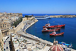 Merchant shipping and cruise ship arriving in Grand Harbour, Valletta, Malta