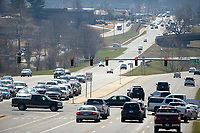 NWA Democrat-Gazette/ANDY SHUPE<br /> Cars pass through the intersection of Joyce Boulevard and College Avenue Thursday, March 15, 2018, in Fayetteville, a place where panhandlers have often been seen. The Fayetteville City Council is considering adopting an amendment to city code that defines the term &ldquo;roadway&rdquo; as from far curb to far curb. The change aims to promote safety by preventing people from standing in the middle of a road.