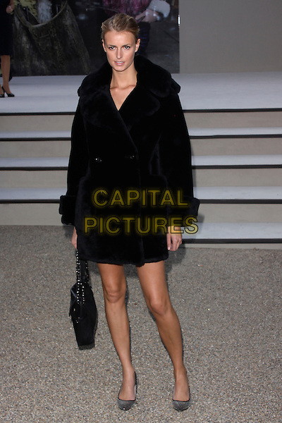 JACQUETTA WHEELER .attending the Burberry Prorsum Spring Summer Collection, during London Fashion Week at the Chelsea College of Art and Design, London, England, UK, September 21st 2010. .LFW show full length coat bag shoes studded studs silver  black fur .CAP/AH.©Adam Houghton/Capital Pictures.