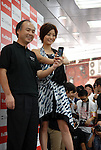 Actress Aya Ueto, who is the image character of mobile carrier SoftBank, appears at a promotional event of Apple Computer's iPhone in Tokyo together with SoftBank CEO Masayoshi Son. 11 July, 2008. (Taro Fujimoto/JapanToday/Nippon News)