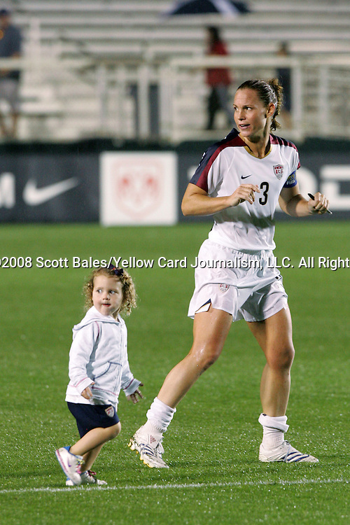 27 April 2008: Christie Rampone (USA) (3), and her daughter Rylie Cate Rampone, jog across the field after the game. The United States Women's National Team defeated the Australia Women's National Team 3-2 at WakeMed Stadium in Cary, NC in a rain delayed women's international friendly soccer match.