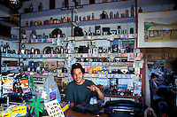 "A man tends shop at the Kaupo Store, a longtime landmark, in Kaupo, Maui. Just past the town of Hana, this shop is one of the only stops on what is referred to as ""the back side."""