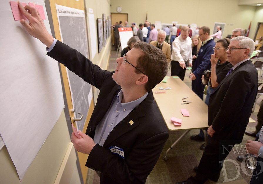 NWA Democrat-Gazette/BEN GOFF @NWABENGOFF<br /> James Walden with the planning team places a comment card on the board for the South West Gateway zone on Thursday, Feb. 18, 2016 during a visioning workshop hosted by Houseal Lavigne Associates at the Bentonville Public Library for the community to learn about and comment on Bentonville Community Plan.
