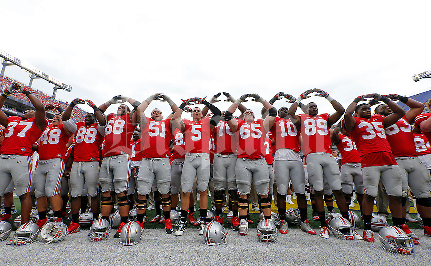 "Ohio State Buckeyes football team sings ""Carmen Ohio"" after their NCAA game against Navy Midshipmen at M&T Bank Stadium in Baltimore, Maryland on August 30, 2014. (Dispatch photo by Kyle Robertson)"
