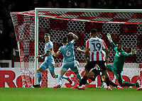 11th February 2020; Griffin Park, London, England; English Championship Football, Brentford FC versus Leeds United; Liam Cooper of Leeds United shoots to score his sides 1st goal in the 39th minute to make it 1-1