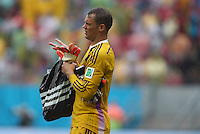 Germany goalkeeper Manuel Neuer leaves the field with a carrier bag at half time