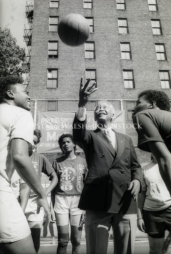 New York, NY - 15 July 1989 - Manhattan Borough President David Dinkins tosses a basketball during a campaign stop.