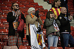 Stoke City 0 Valencia 1, 16/02/2012. Britannia Stadium, UEFA Europa League. Some of the small band of around 60 visiting supporters react with delight at the Britannia Stadium, Stoke-on-Trent, after the UEFA Europa League last 32 first leg between Stoke City and visitors Valencia. The match ended in a 1-0 victory from the visitors from Spain. Mehmet Topal scored the only goal in the first half in a match watched by a crowd of 24,185. Photo by Colin McPherson.