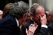 Former President George W. Bush, right, cries after speaking during the State Funeral for his father, former President George H.W. Bush, at the National Cathedral, Wednesday, Dec. 5, 2018, in Washington.<br /> Credit: Alex Brandon / Pool via CNP