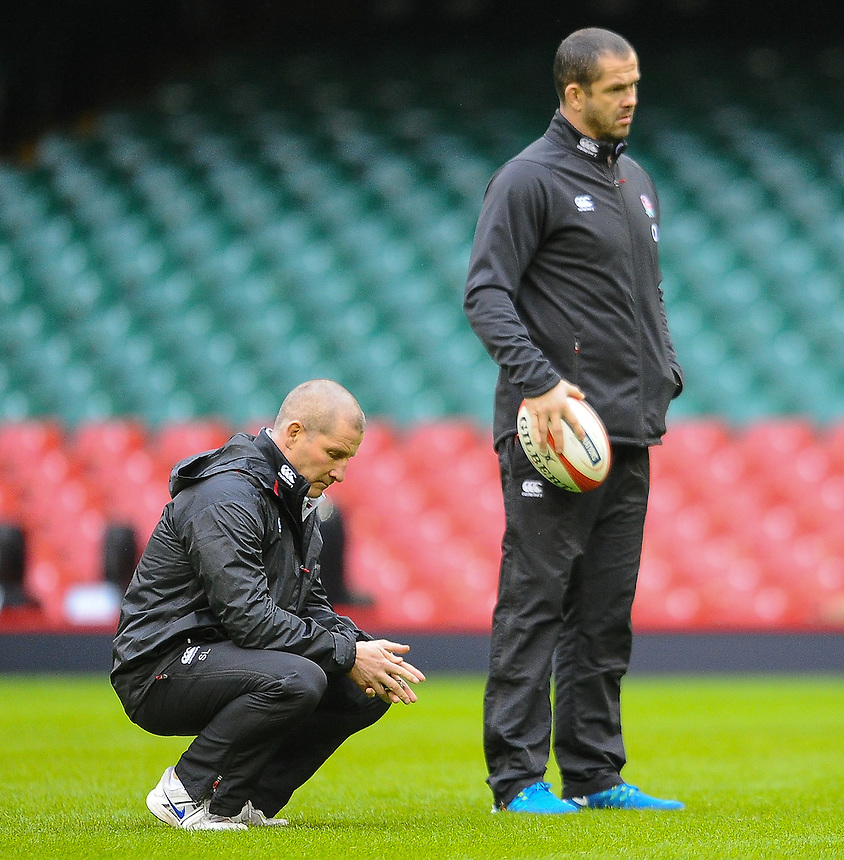 England Head Coach Stuart Lancaster inspects the new surface at the millennium stadium<br /> <br /> Photographer Craig Thomas/CameraSport<br /> <br /> Rugby Union - 6 nations - England squad training - Thursday 5th Feburary - Millennium Stadium - Cardiff<br /> <br /> &copy; CameraSport - 43 Linden Ave. Countesthorpe. Leicester. England. LE8 5PG - Tel: +44 (0) 116 277 4147 - admin@camerasport.com - www.camerasport.com