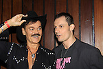 Actor Keith Collins poses with Randy Jones (Village People) who is celebrating birthday and marriage (this morning September 13, 2013) with a celebration at the 13th Annual Kings & Cowboys at DL in New York City, New York.  (Photo by Sue Coflin/Max Photos)